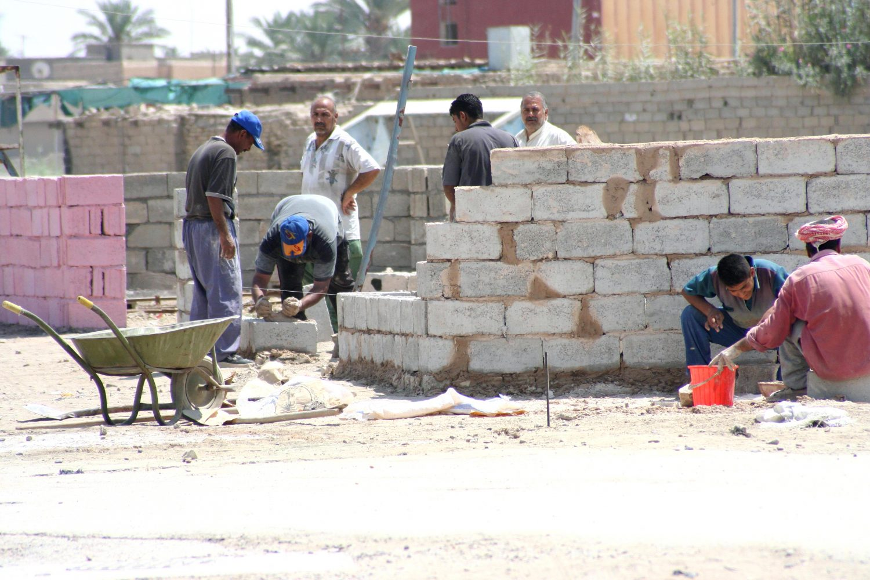 Workers rebuilding ramadi town iraq